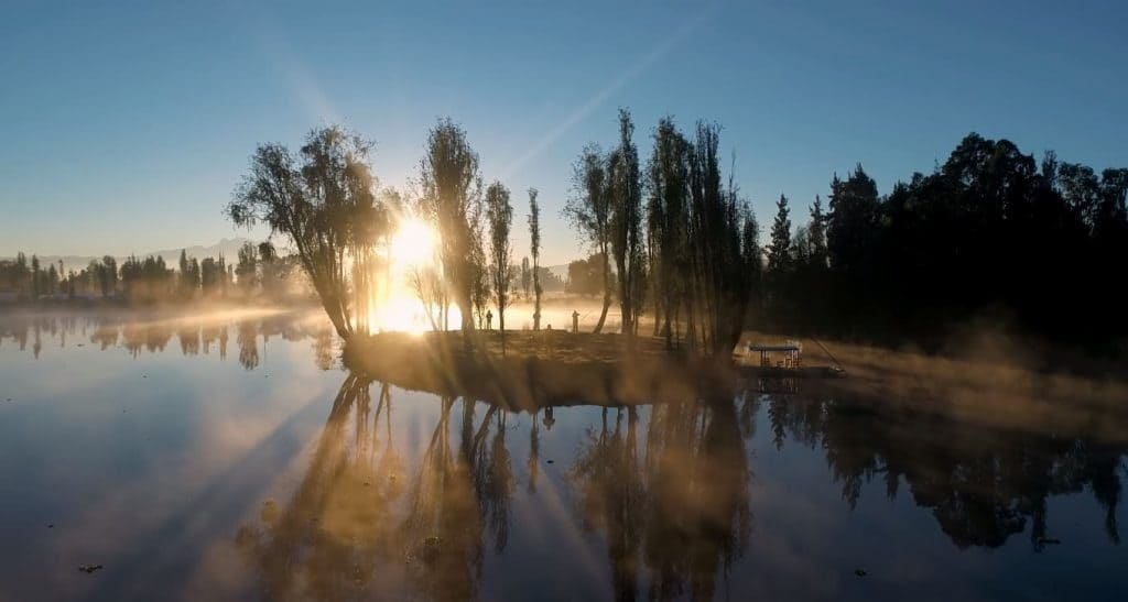 Sunrise on the canals of Xochimilco lake